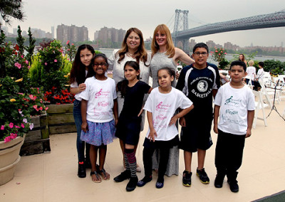 Anna Stampfli with Executive Superintendent of NYC, Dolores Esposito and District Orchestra students